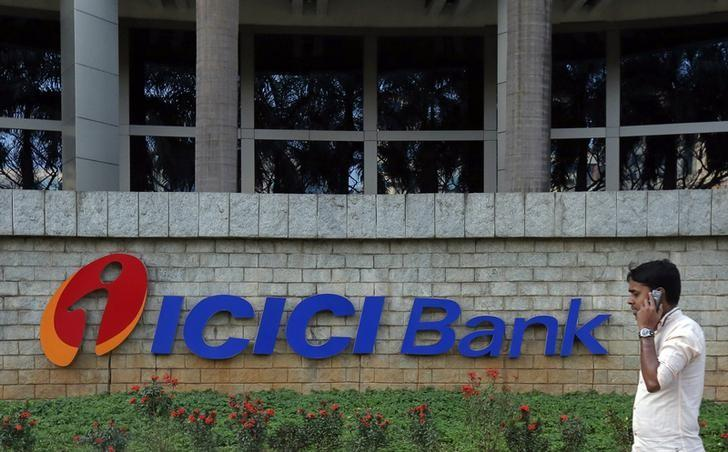A pedestrian walks past a logo of ICICI Bank at its headquarters in Mumbai January 30, 2015. Credit: Reuters/Shailesh Andrade/Files