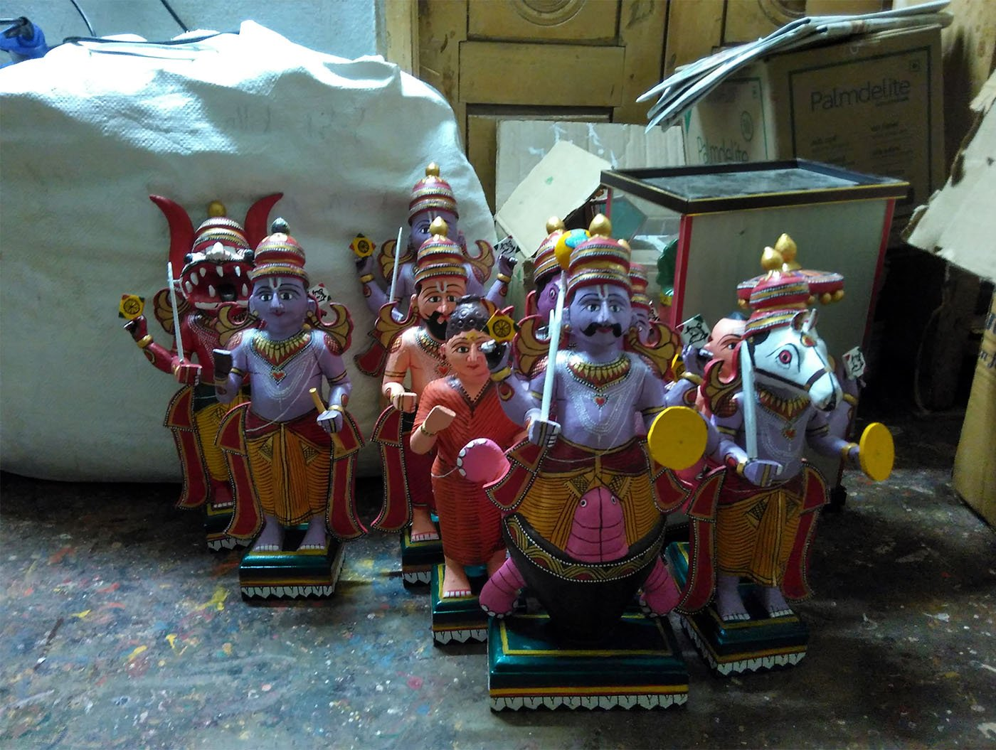 "Wooden idols depicting the 10 avatars of Vishnu: 'We also make toys of mythological and fictional characters,' says V. Venkayya, 80. ""But what I love is depicting the things and people I see every day'. Credit: Rahul Maganti"