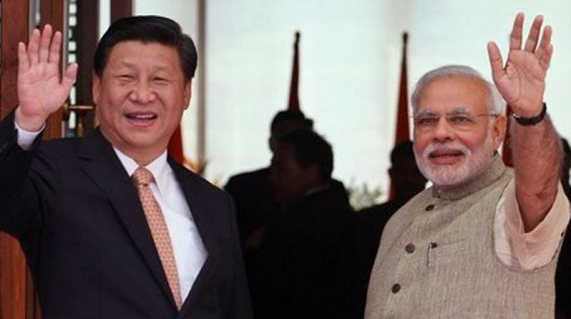 Chinese President Xi Jinping with Indian Prime Minister Narendra Modi. Credit: PTI