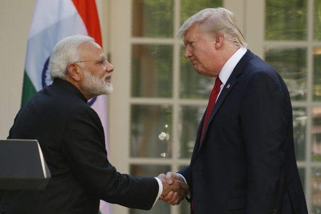 U.S. President Donald Trump (R) greets Indian Prime Minister Narendra Modi during their joint news conference in the Rose Garden of the White House in Washington, U.S., June 26, 2017. REUTERS/Kevin Lamarque