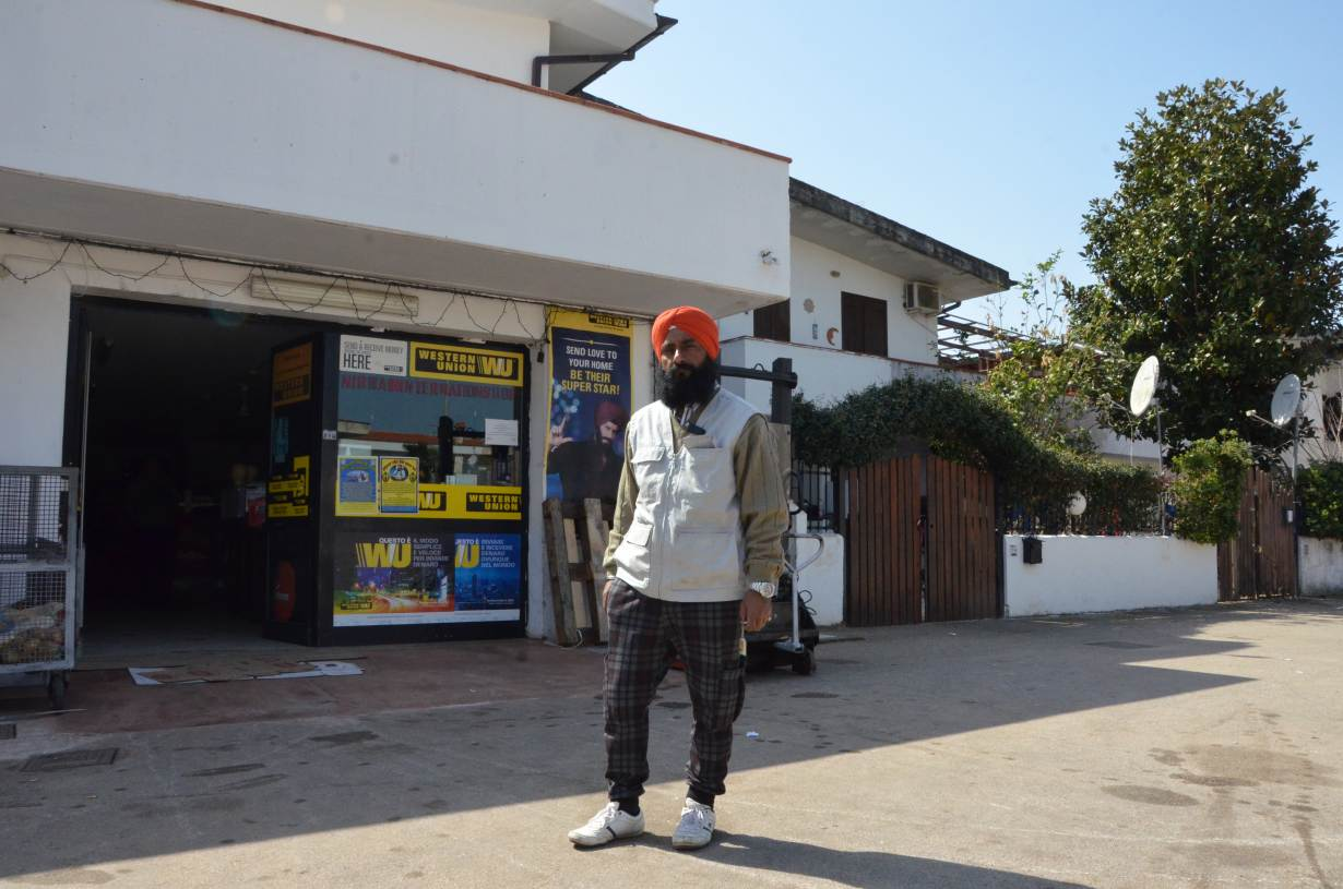 Gurmukh Singh, head of an Indian community association in Rome's Lazio region, stands outside his shop in Borgo Hermada, Latina, Italy. March 25, 2017. Credit: Thomson Reuters Foundation/Umberto Bacchi