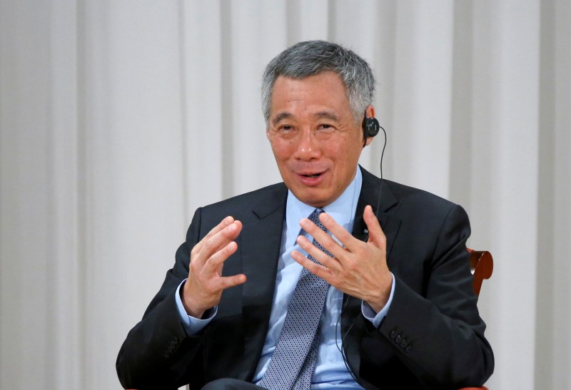 Singapore PM's Fighting Siblings Debate Private Settlement or Court Case