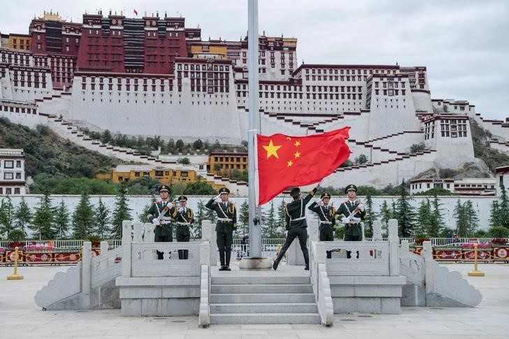 The Chinese national flag is raised during a ceremony marking the 96th anniversary of the founding of the Communist Party of China (CPC) at Potala Palace in Lhasa, Tibet Autonomous Region, China, July 1, 2017. CNS/He Penglei via REUTERS/Files