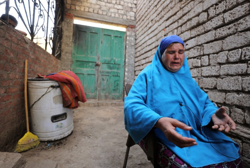 Nabila Gomaa, mother of Mohamed Salama, a faculty student who has been missing in Libyan desert since 10 months, reacts in the village of Tarfa al-Kom in Minya province, Egypt, July 12, 2017. Credit: Reuters/Mohamed Abd El Ghany
