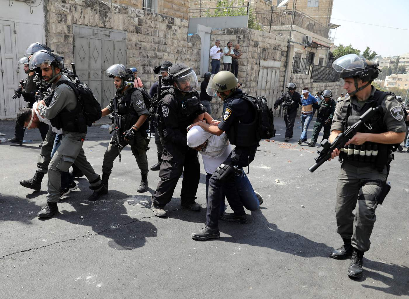 Israeli security forces arrest Palestinian men following clashes outside Jerusalem's Old city, July 21, 2017. Credit: Reuters/Ammar Awad