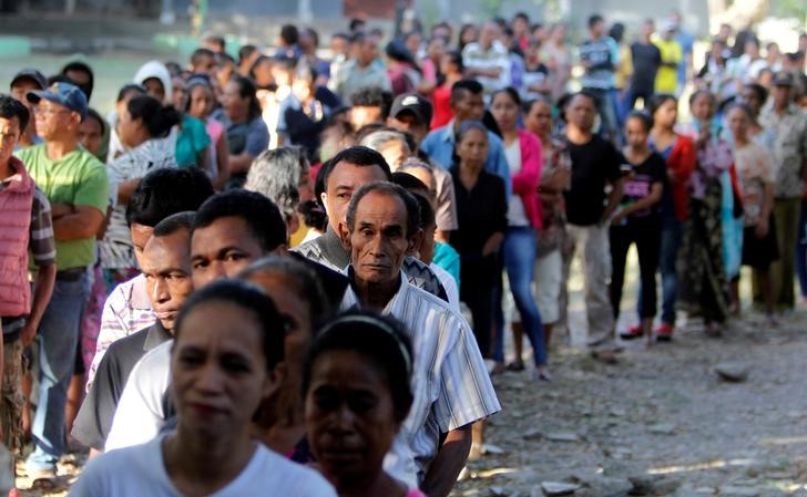 East Timorese Queue to Cast Votes in Parliamentary Election