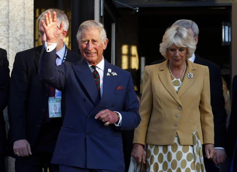 Britain's Prince Charles and Camilla, Duchess of Cornwall, wave goodbye in Winnipeg, Manitoba, May 21, 2014. Credit: Reuters/Mark Blinch