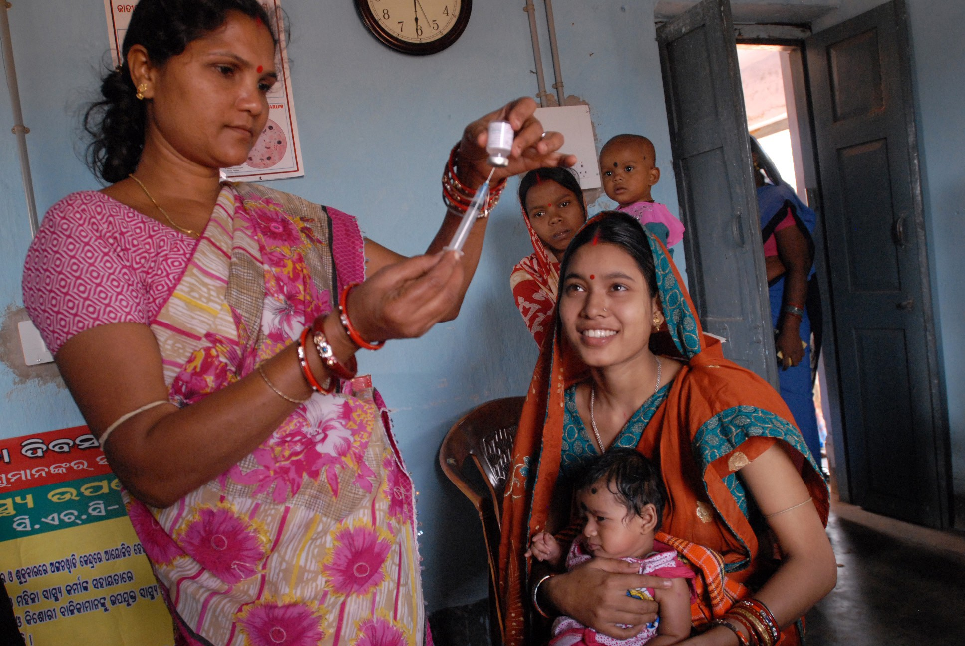 A community health worker gives a vaccination in Odisha state, India. Credit: Wikimedia