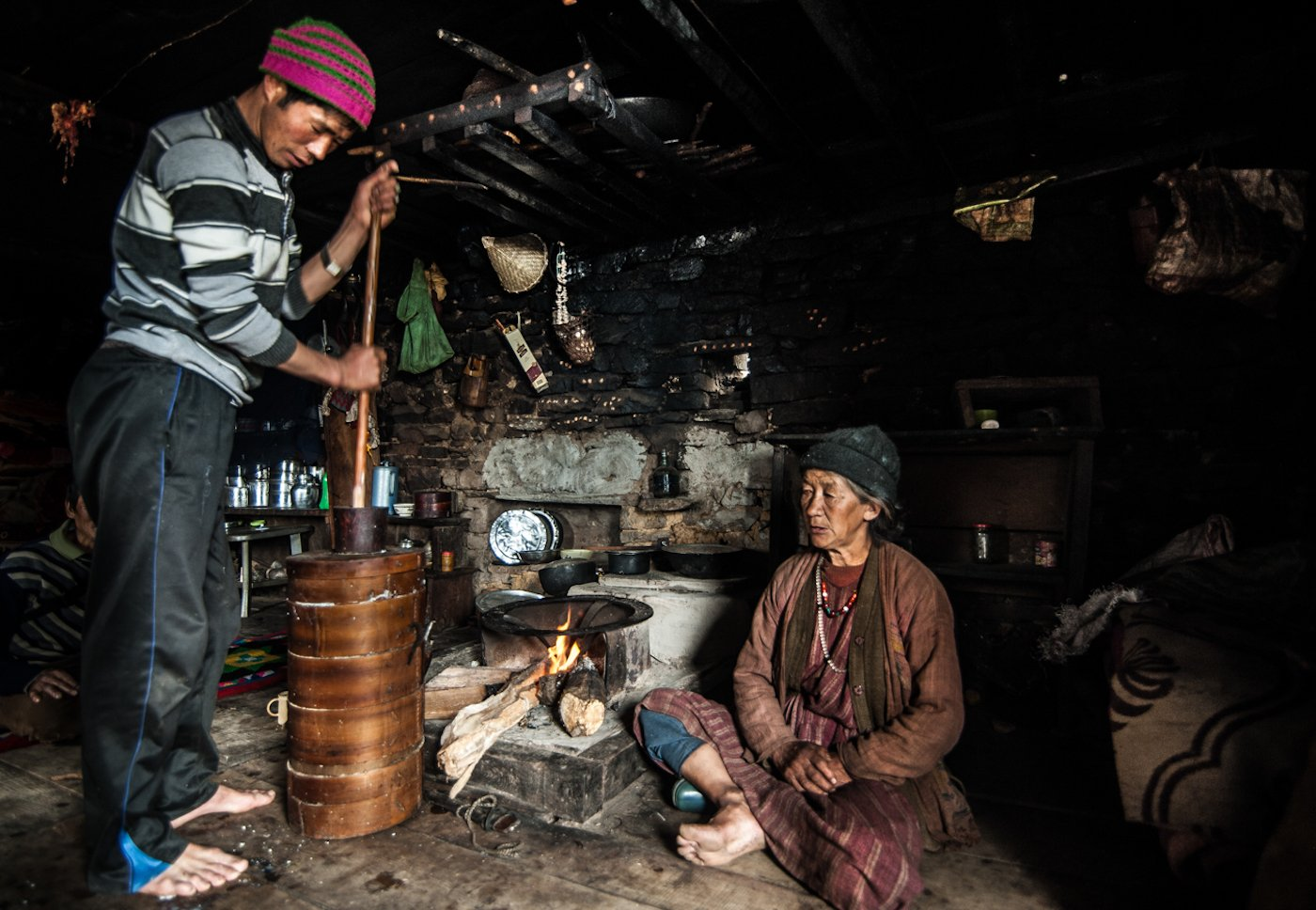 A Brokpa herdsman making butter andchurpi(traditional cheese) in his winter settlement in Lagam. Both items bring in some income for Brokpa families. Credit: Ritayan Mukherjee