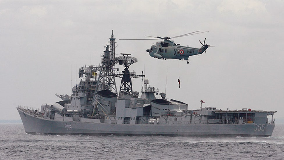 An Indian Navy helicopter takes part in a joint Indo-Lanka naval exercise at Trincomalee navy base, about 275km east of Colombo. Credit: Reuters
