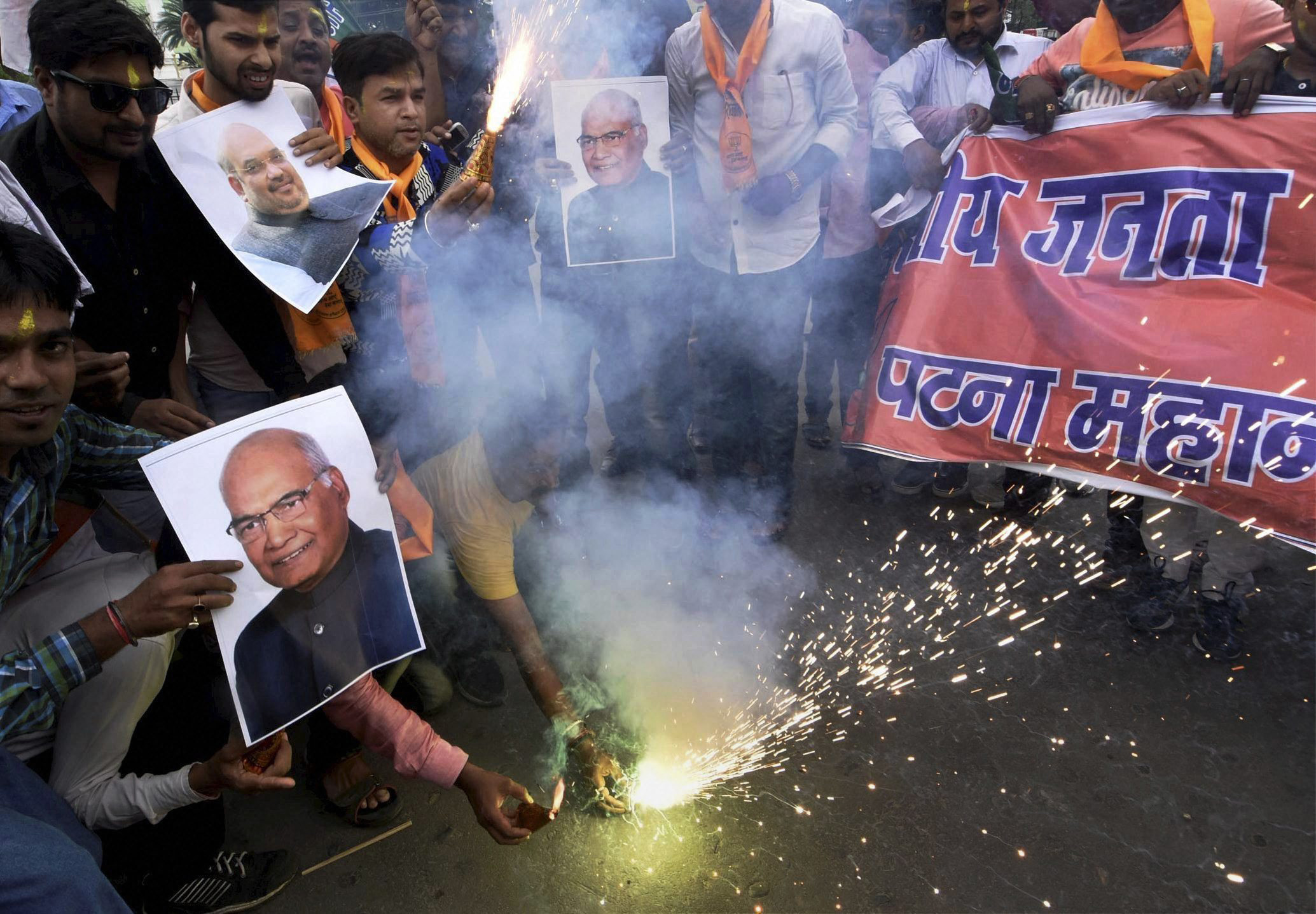 BJP workers celebrate the early lead of Ram Nath Kovind in Patna on Wednesday. Credit: PTI
