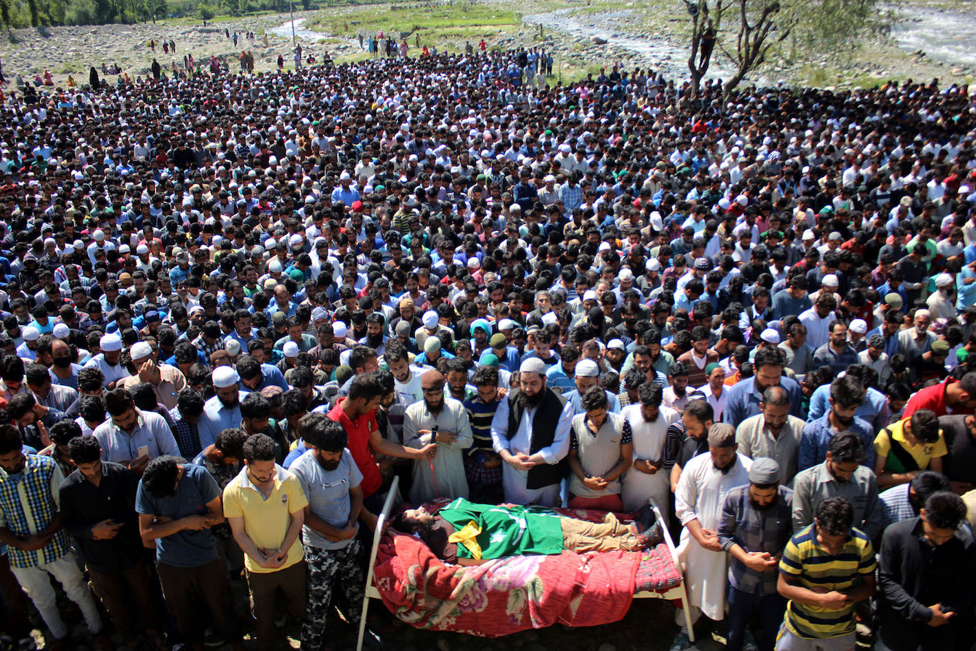 Kashmiri villagers offer funeral prayers of Bashir Lashkari in his native village of Sopshali Kokernag in South Kashmir on July 2,2017. Credit: Vikar Syed