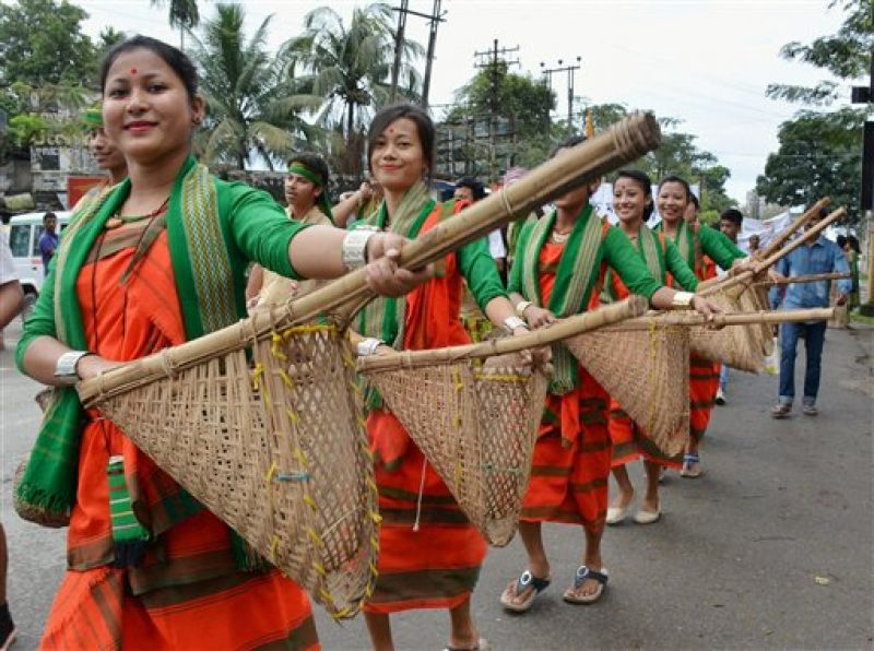Women dressed in traditional Assamese attire taking out a cultural procession during Namami Brahmaputra festival at Dibrugarh, Assam. Credit: PTI