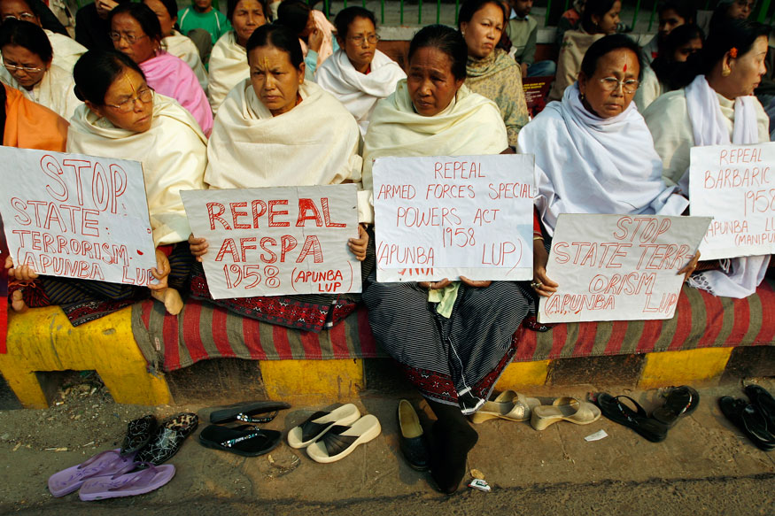 Women hold placards during a protest against the Armed Forces Special Powers Act. Credit: Reuters