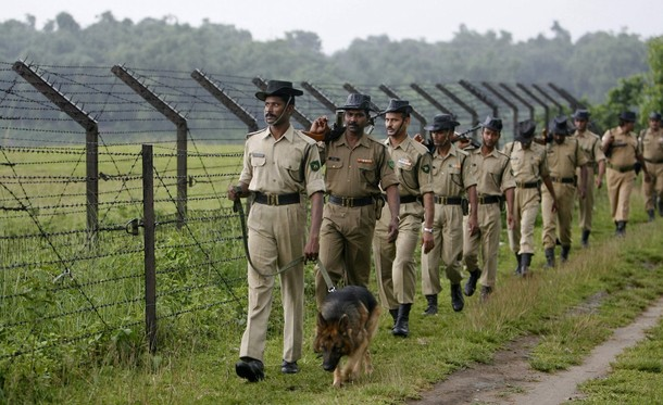 Indian Border Security Force on Patrol of the Indio-Bangladesh border fence.