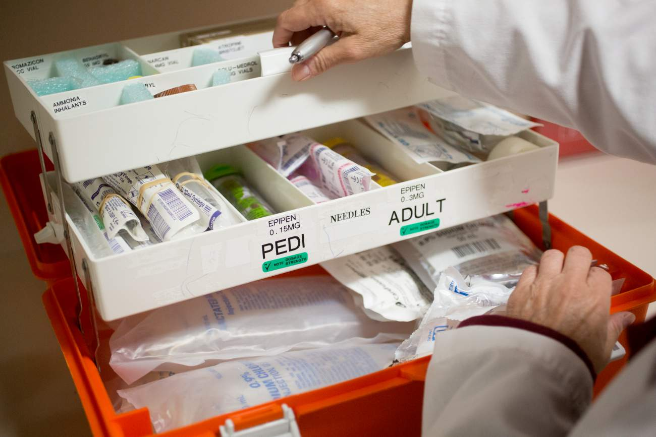 Pharmacist Mary Caban, replaces expired medication in drug boxes throughout Newton-Wellesley Hospital, April 27, 2017. Credit: Erik Jacobs for ProPublica