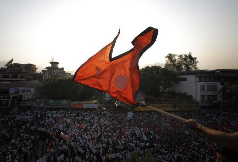 The national flag of Nepal is waved during a mass gathering in Kathmandu. Credit: Reuters/Navesh Chitrakar