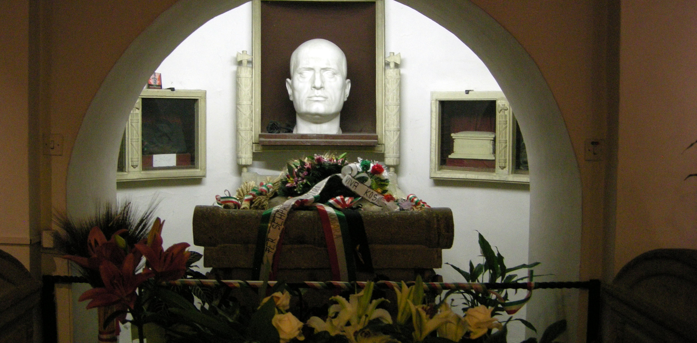 Benito Mussolini's bust and crypt in San Cassiano cemetery are a sensitive topic in Predappio, Italy. Credit: Wikimedia Commons/Saiko