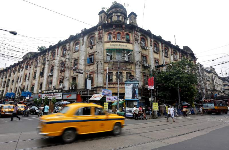 A taxi drives past the Mercantile office building at 9/12, Lalbazar Street, in Kolkata, August 14, 2017. Credit: Reuters/Rupak De Chowdhuri