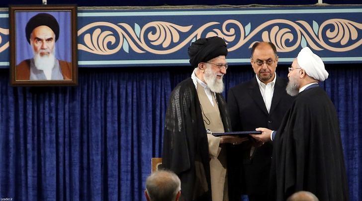 Iran's President Hassan Rouhani receives the presidential mandate from Iran's Supreme Leader Ayatollah Ali Khamenei during an endorsement ceremony, in Tehran, Iran, August 3, 2017. Credit President.ir/Handout via Reuters