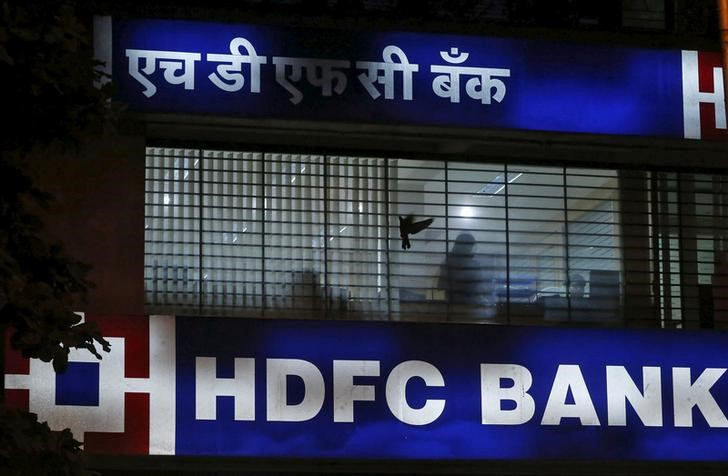 FILE PHOTO: A bird flies past a window of a HDFC Bank branch office in Mumbai, India, October 21, 2015. Credit: Reuters/Shailesh Andrade/File Photo