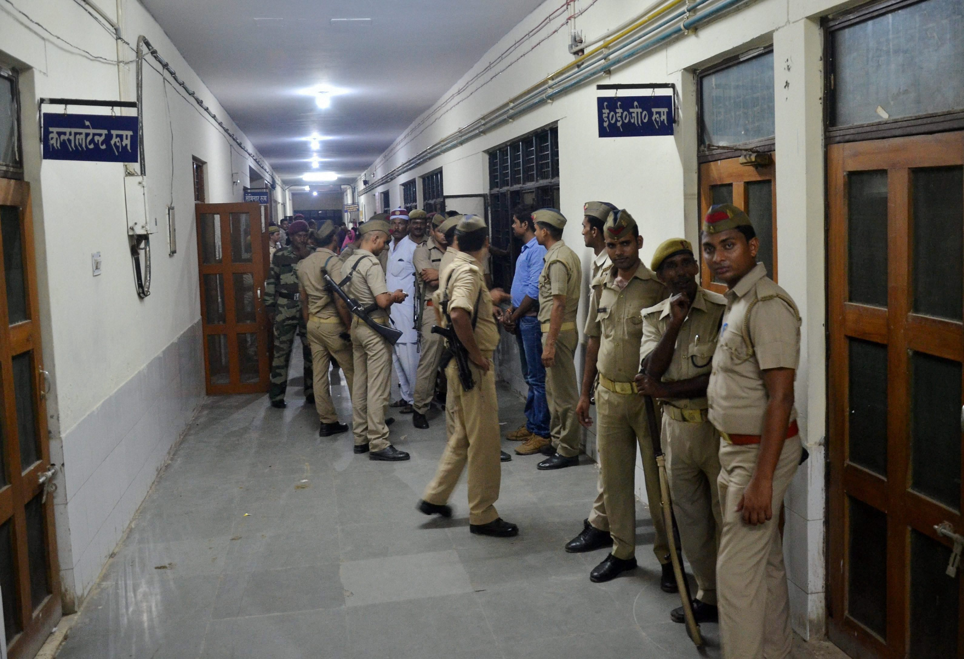 UP police inside the BRD Hospital for the investigation into the death. Credit: PTI