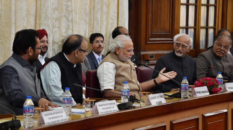 Hamid Ansari with Prime Minister Narendra Modi, Deputy Chairman PJ Kurien and Finance Minister Arun Jaitley at an all-party meeting ahead of the budget session at Parliament House. Credit: PTI/Files