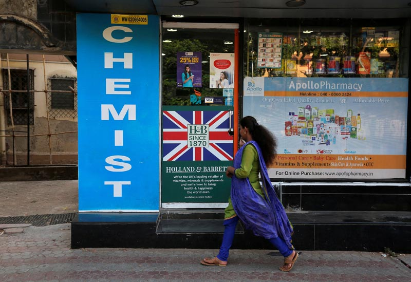 A woman walks past a chemist shop in Mumbai, India, on April 28, 2017. Credit: Reuters/Files
