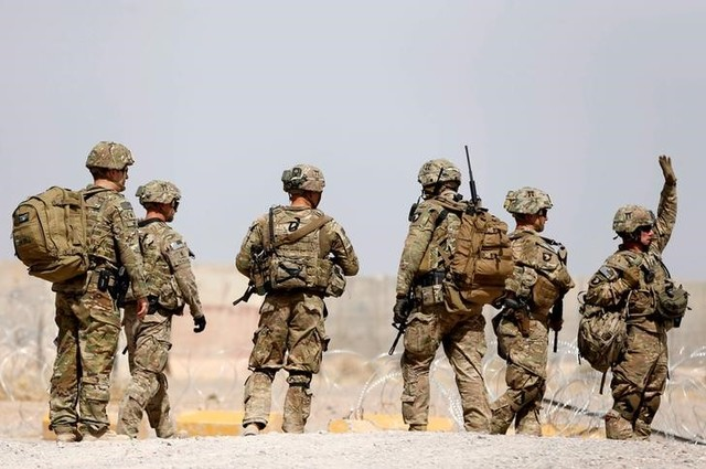 US troops walk outside their base in Uruzgan province, Afghanistan, July 7, 2017. Credit: Reuters/Omar Sobhani/File Photo