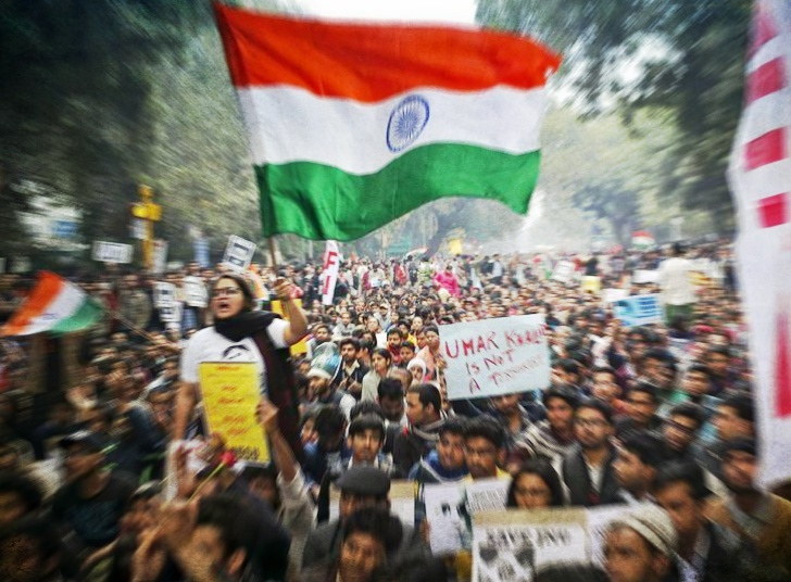 A demonstrator shouts slogans and waves the Indian national flag as she takes part in a protest demanding the release of Kanhaiya Kumar, a Jawaharlal Nehru University (JNU) student union leader accused of sedition, in New Delhi, India, February 18, 2016. REUTERS/Anindito Mukherjee