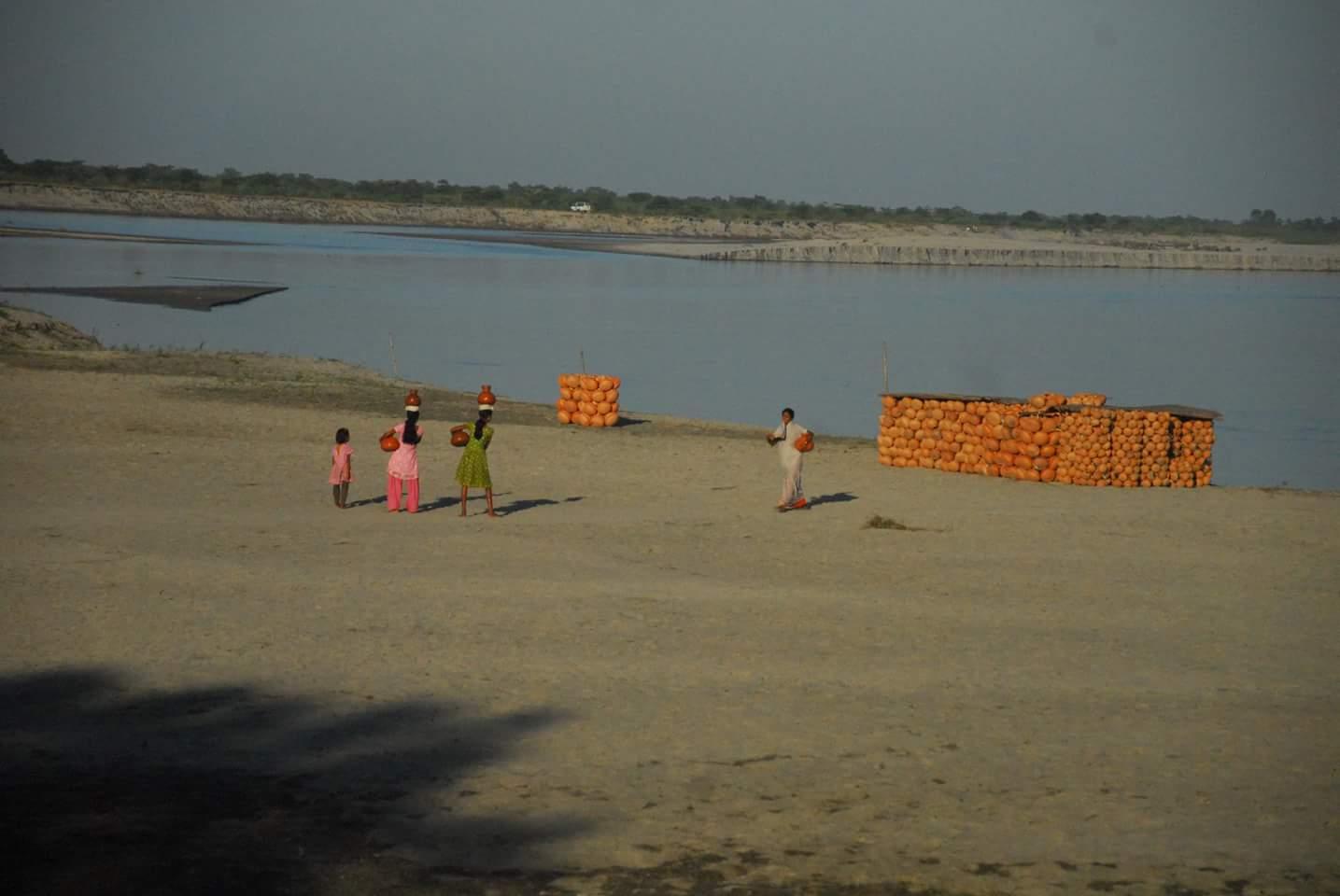 Clay pots made by the resident of Majauli stacked by the Brahmaputra river. Credit: Sangeeta Barooah Pisharoty
