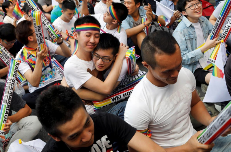 Supporters hug each other during a rally after Taiwan's constitutional court ruled that same-sex couples have the right to legally marry. Credit: Tyrone Siu