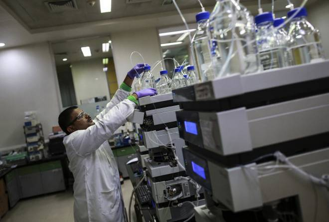 An employee works inside a laboratory at Piramal's Research Centre in Mumbai August 11, 2014. Credit: Reuters/Danish Siddiqui/Files