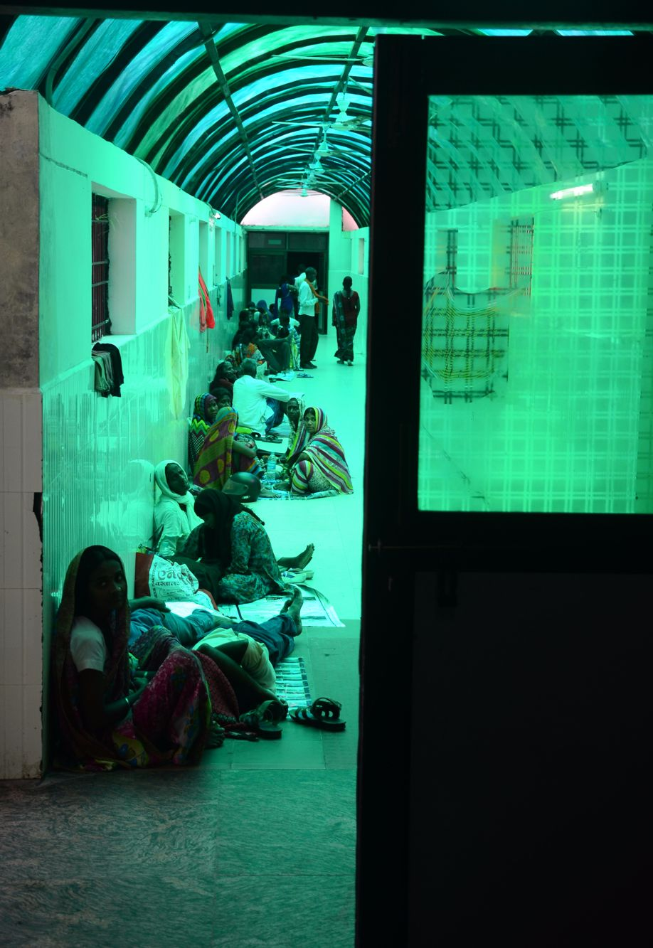 Crowds sitting in one of the numerous alleyways in the hospital, where most spend the night too