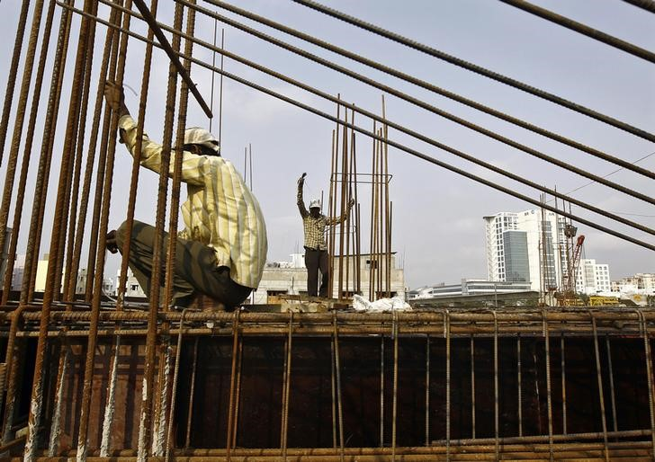Labourers work at the construction site of a commercial complex in Kolkata February 28, 2015. Credit: Reuters/Rupak De Chowdhuri/Files