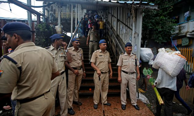 Policemen inspect the site of a deadly stampede at Parel and Elphinstone Road stations in Mumbai. Credit: Reuters