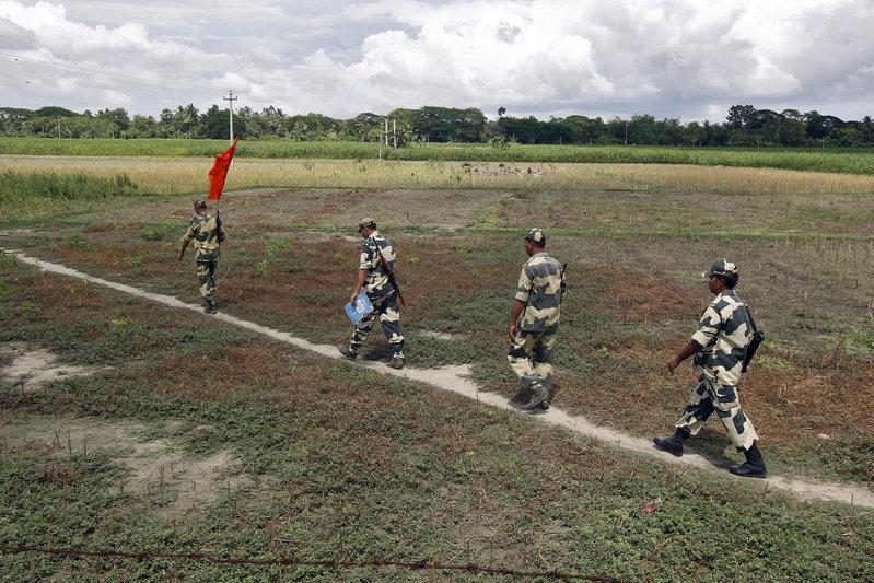Indian Border Security Force (BSF) soldiers walk across the open border with Bangladesh to attend a flag meeting in West Bengal, India, June 20, 2015. Credit: Reuters/Rupak De Chowdhuri/File photo