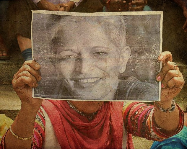 A protestor holds up Gauri Lankesh's photograph. Credit: PTI