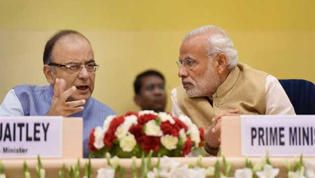 Prime Minister Narendra Modi talks to Union finance minster Arun Jaitley at the Delhi Economics Conclave 2015. Credit: PTI/Shirish Shete/Files