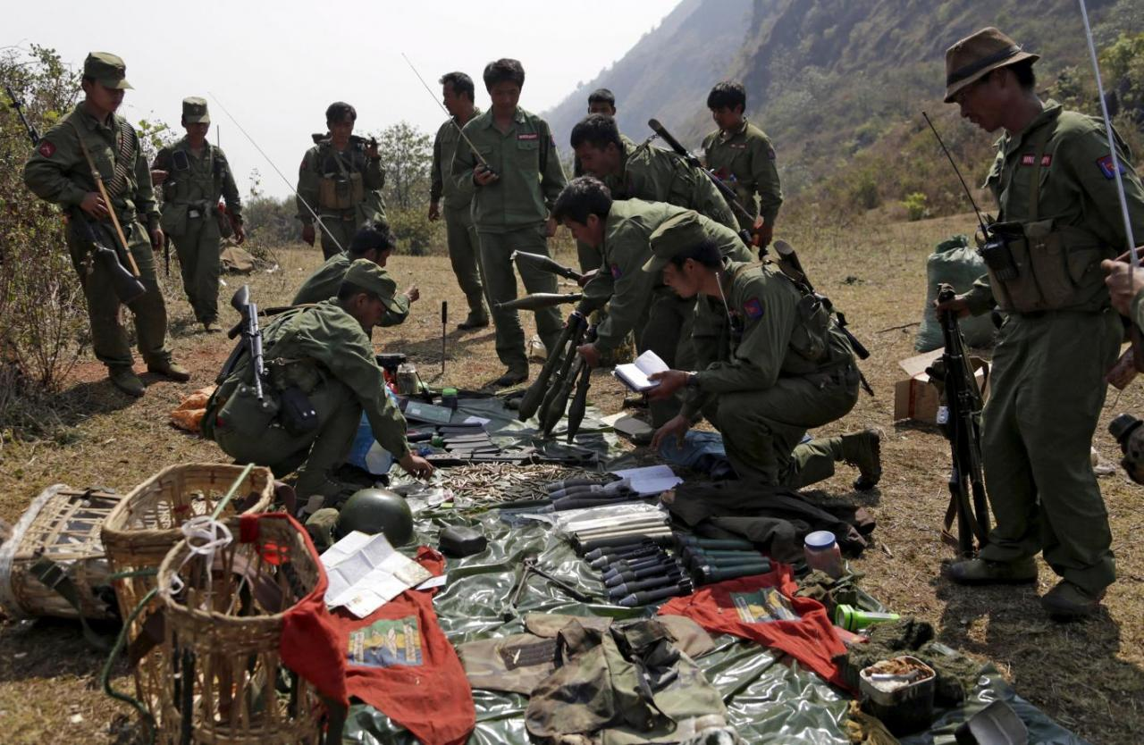 Rebel soldiers of the Myanmar National Democratic Alliance Army (MNDAA) examine weapons and ammunition at a military base in Kokang region in this March 10, 2015 file photo. Credit: Reuters/Stringer/Files