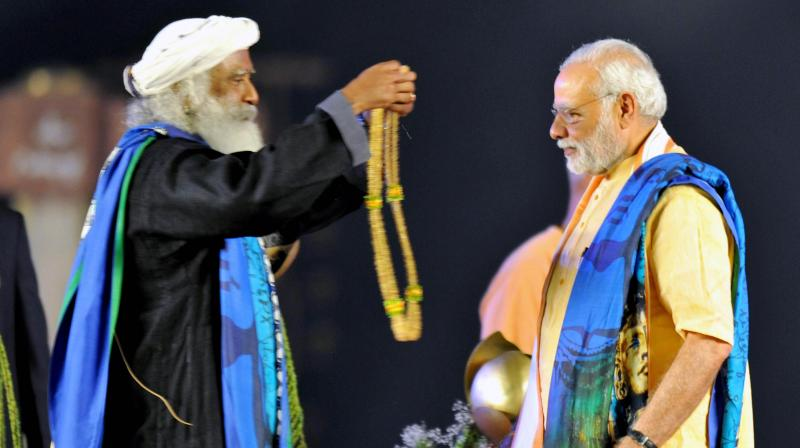 Prime Minister Narendra Modi being greeted by Jaggi Vasudev during the unveiling function of a 112-feet statue of Shiva at Isha Foundation in Coimbatore. Credit: PTI