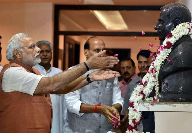 Prime Minister Narendra Modi and home minister Rajnath Singh offer tributes to Deendayal Upadhyaya. Credit: PTI