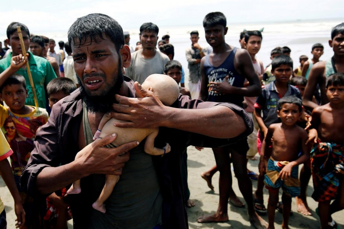 Nasir Ahmed cries as he holds his son after he was killed when a boat with fleeing Rohingya capsized off the coast of Bangladesh, in Teknaf, Bangladesh. Credit: Mohammad Ponir Hossain/Reuters