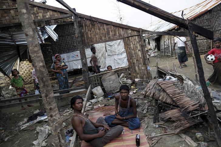 Rohingya people pass their time in a damaged shelter in Rohingya IDP camp outside Sittwe, Rakhine state on August 4, 2015. Credit: Reuters/Soe Zeya Tun/Files