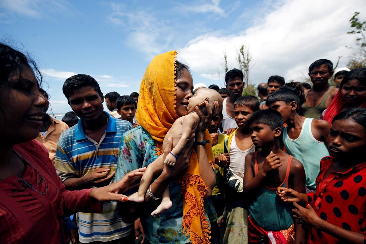 Hamida with her baby's body. Credit: Mohammad Ponir Hossain/Reuters