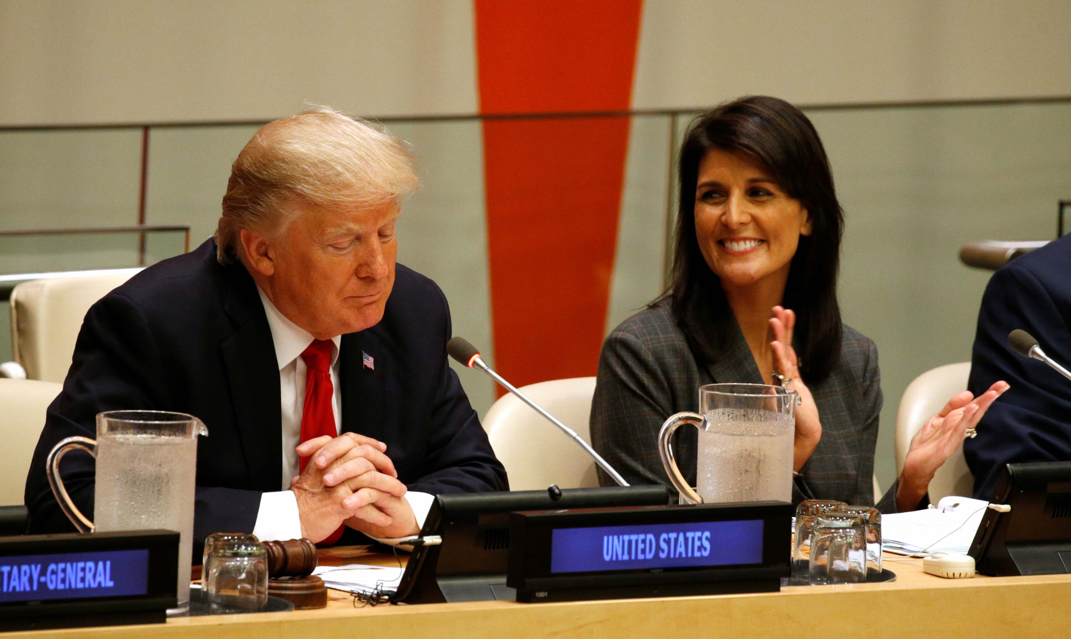 US Ambassador the the UN Nikki Haley applauds as US President Donald Trump speaks during a session on reforming the United Nations at UN Headquarters in New York, September 18, 2017. Credit: Reuters/Kevin Lamarque