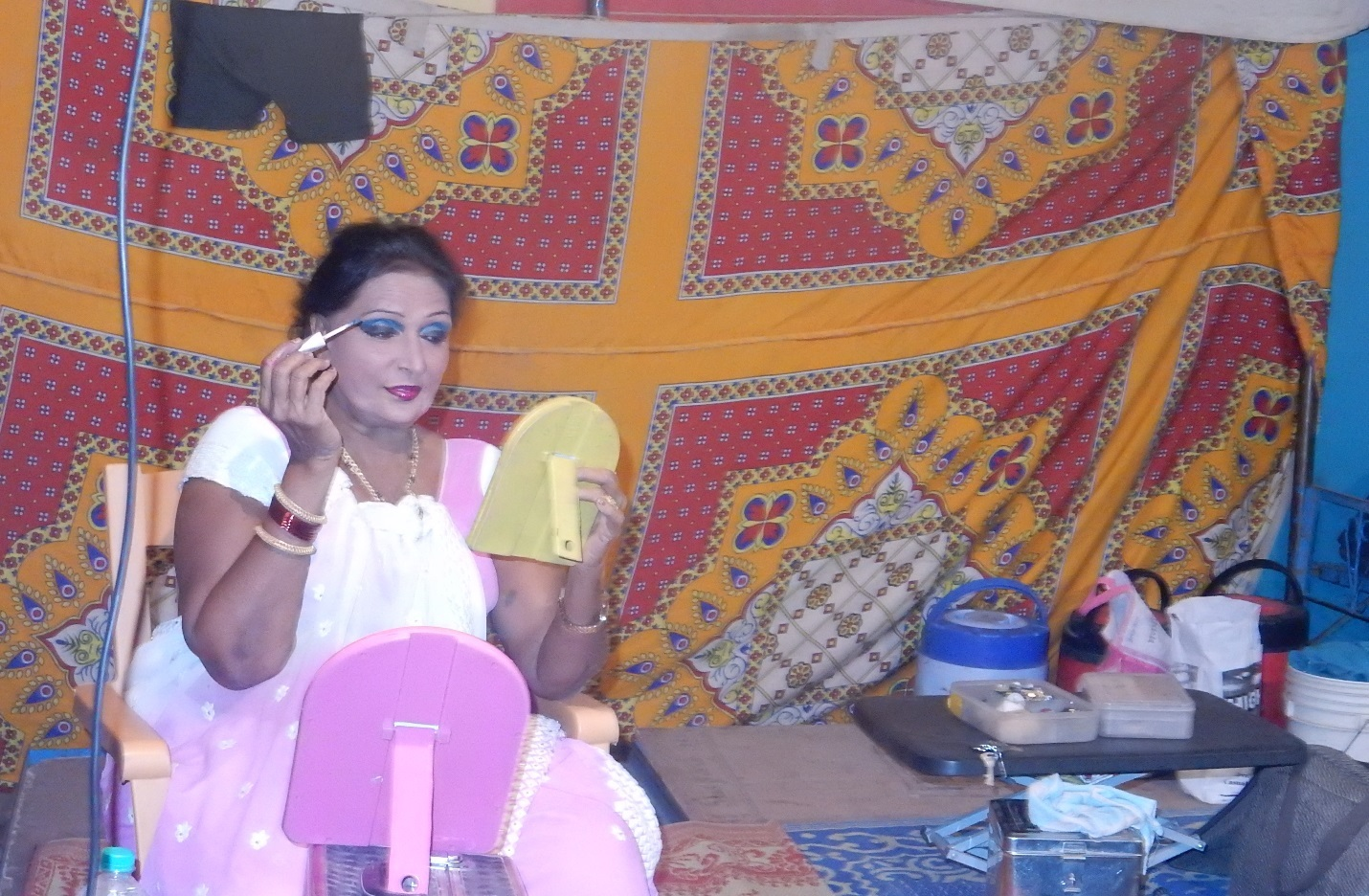 Mangalatai wearing make-up in her tent. She continues her promise to perform in tamasha. Credit: Shailaja Paik