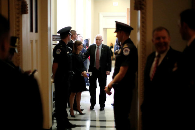 U.S. Senator John McCain (R-AZ) (C) departs after the weekly Republican caucus policy luncheon at the U.S. Capitol in Washington, U.S. September 19, 2017. Credit: Reuters