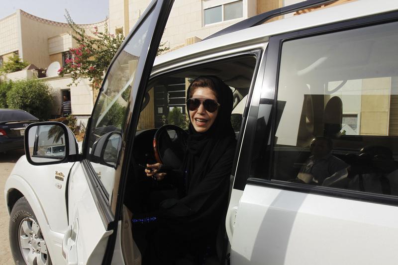 Female driver Azza Al Shmasani alights from her car. Credit: Reuters/Fahad Shadeed