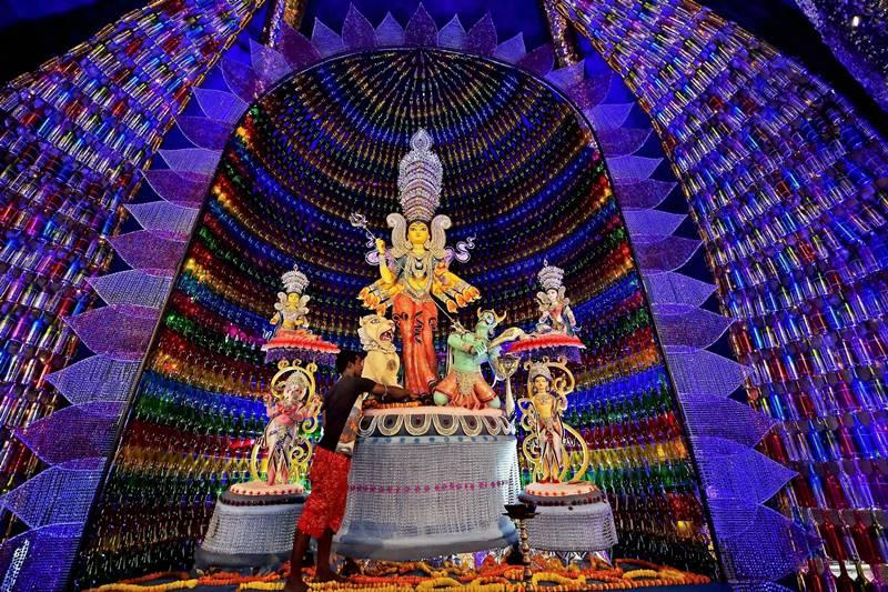 A view of a community Durga puja pandal made up of bottles in Kolkata. Credit: PTI